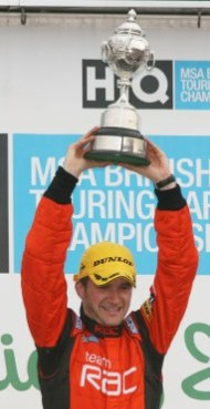 Colin holds the British Touring Cars Championship trophy aloft