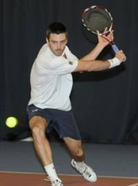 Colin Fleming practising at the Gannochy National Tennis Centre