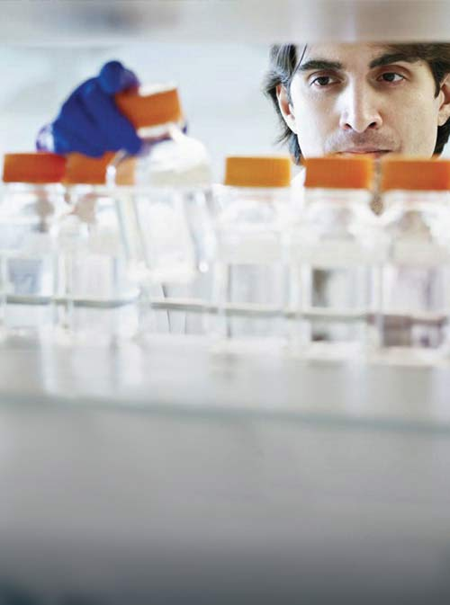 Scientist in a laboratory filling test tubes