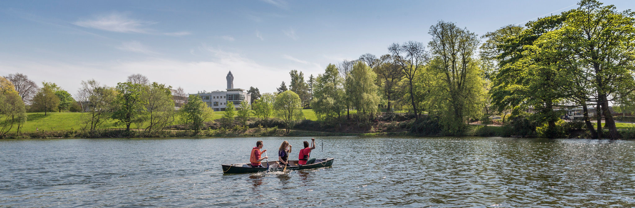 Canoers on campus loch