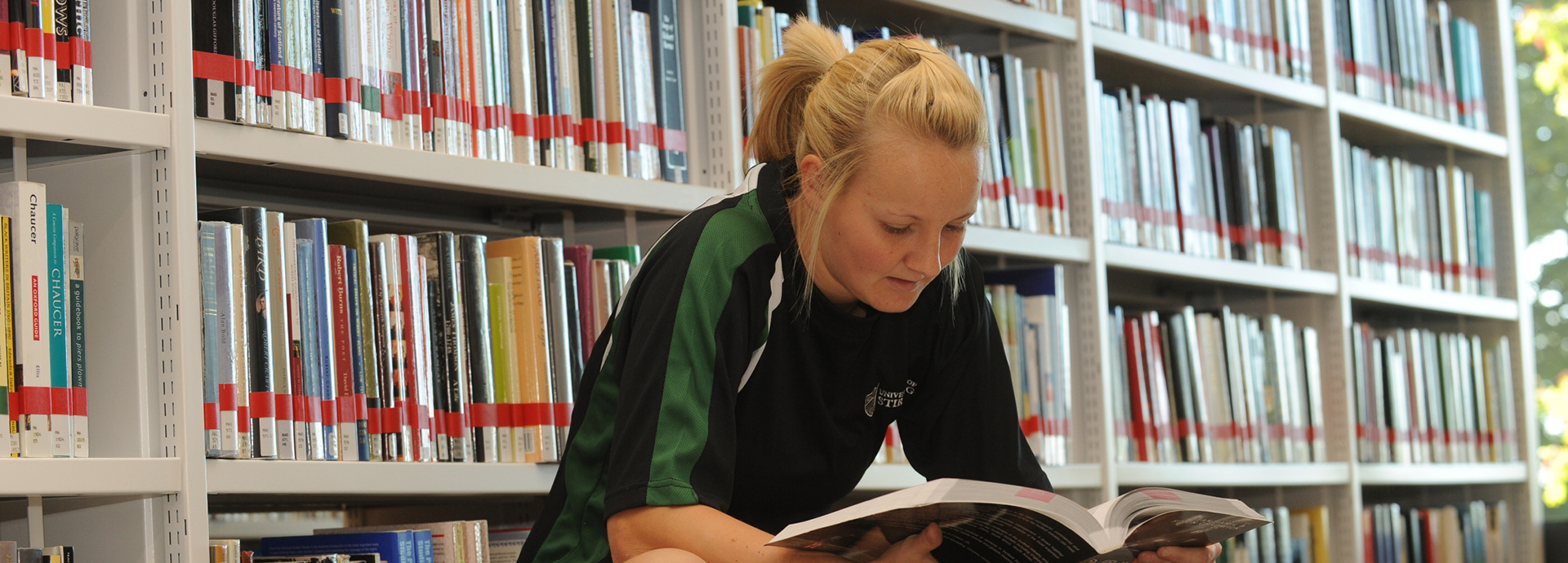 Sport student reading in library