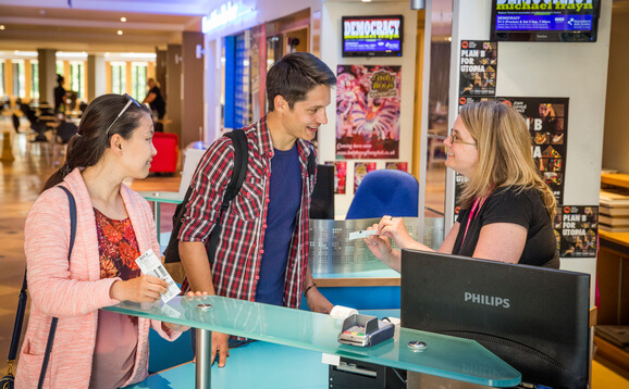 Students buying tickets at the Macrobert Arts Centre