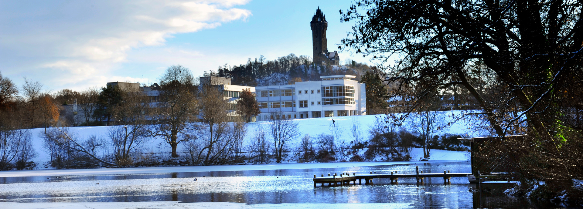 Winter scene of loch, Stirling University campus and Wallace Monument