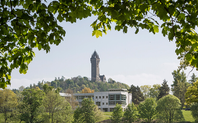 Image of the campus with the Wallace Monument in the background