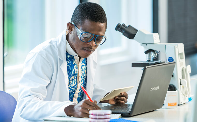 Male student doing research in lab