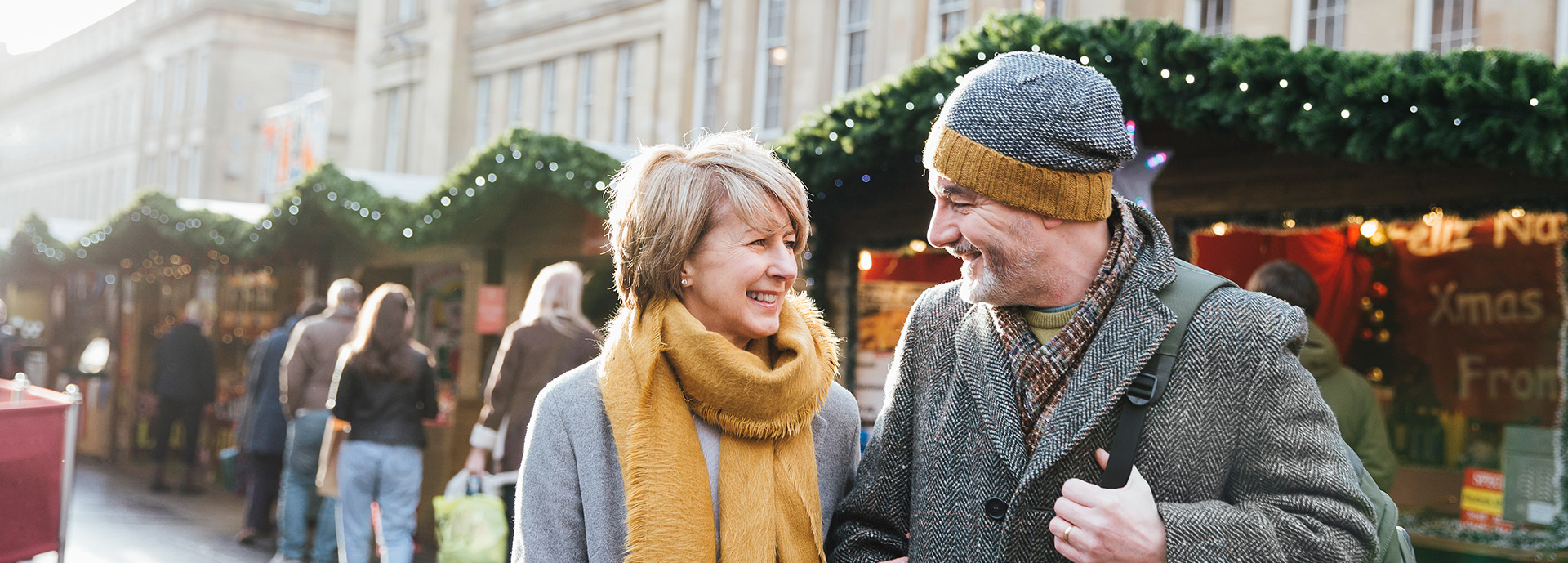 Image of a mature couple at market smiling