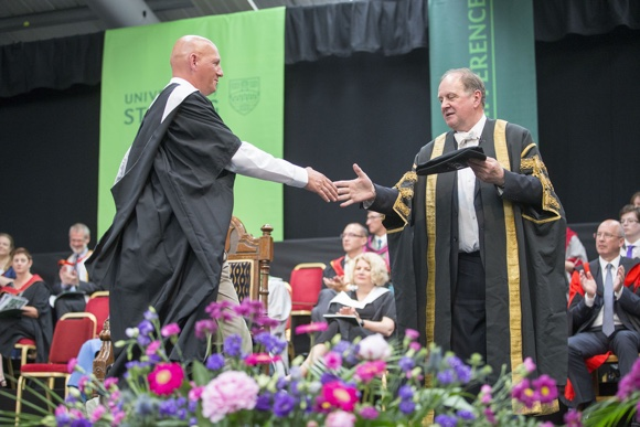 Graduate receiving degree from Chancellor