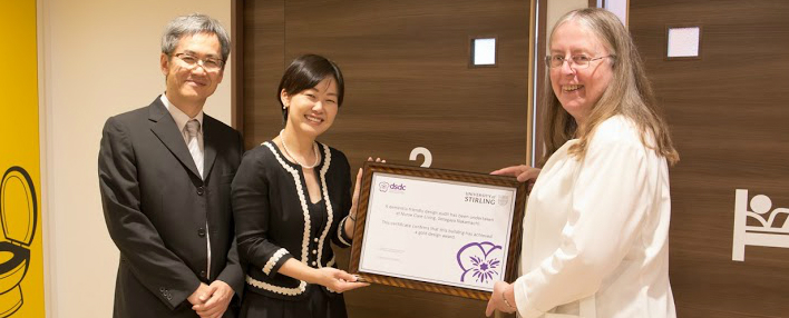 Tokyu Land Corporation is presented with a gold accreditation for dementia design by the University of Stirling's Professor Alison Bowes.