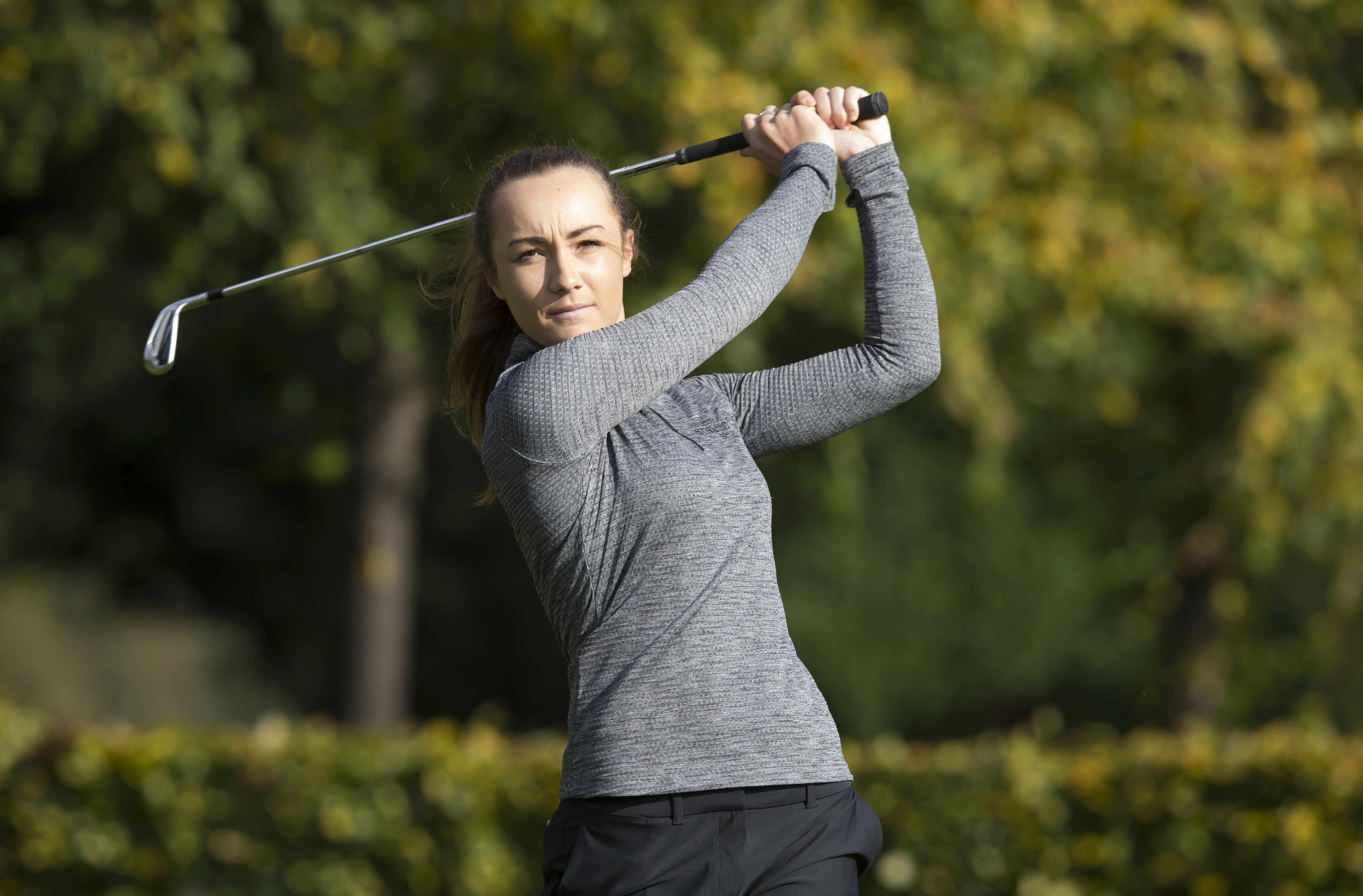 Hazel MacGarvie playing golf