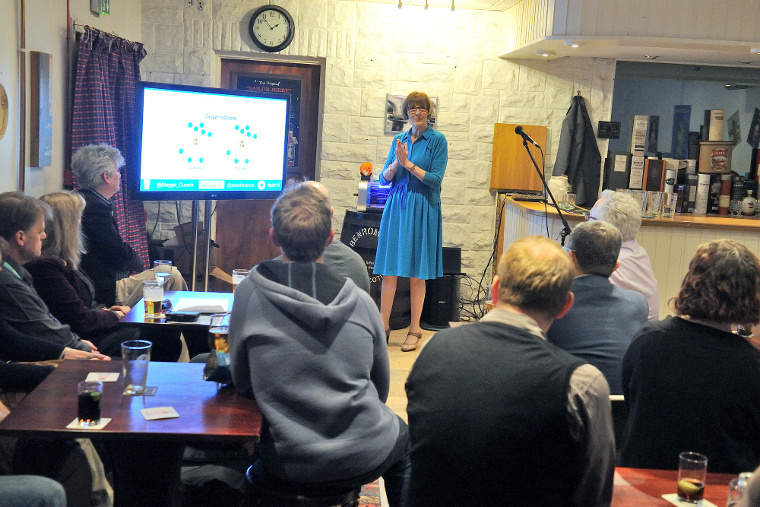 Professor Maggie Cusack presents to patrons of the Curly Coo, Stirling