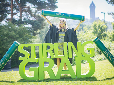 Graduate at Stirling Grad sign