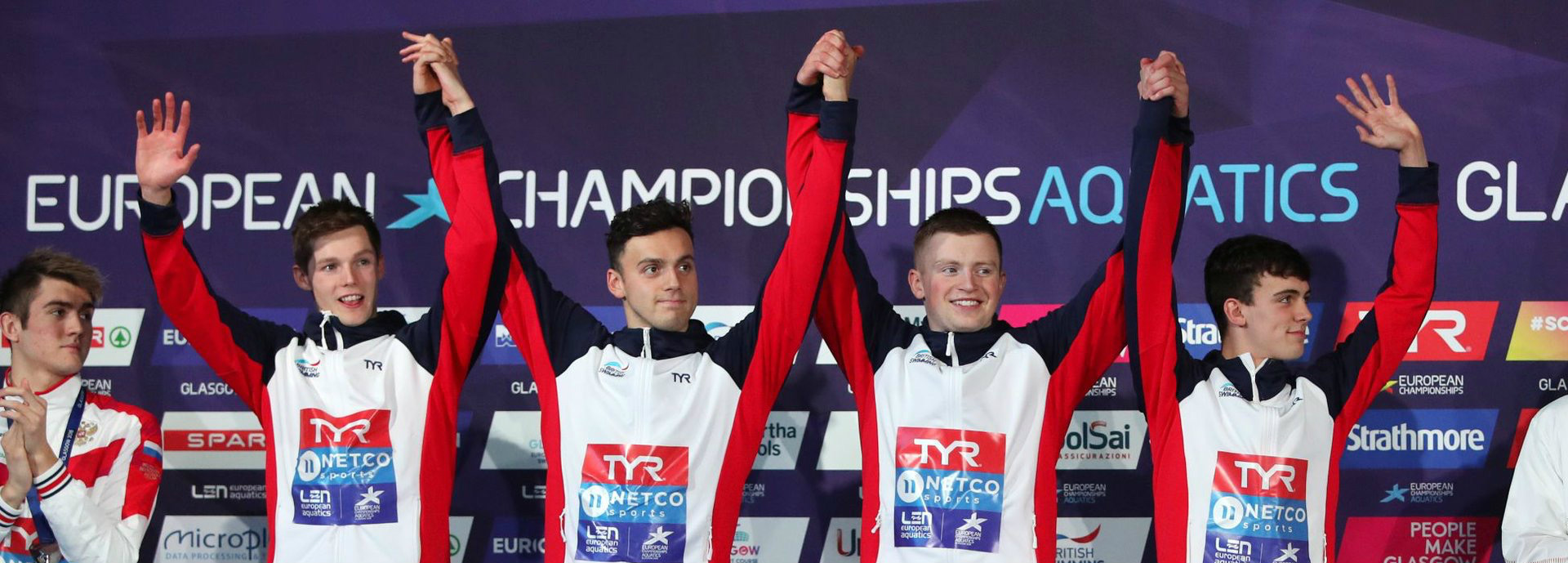 Duncan Scott celebrates with GB teammates on podium