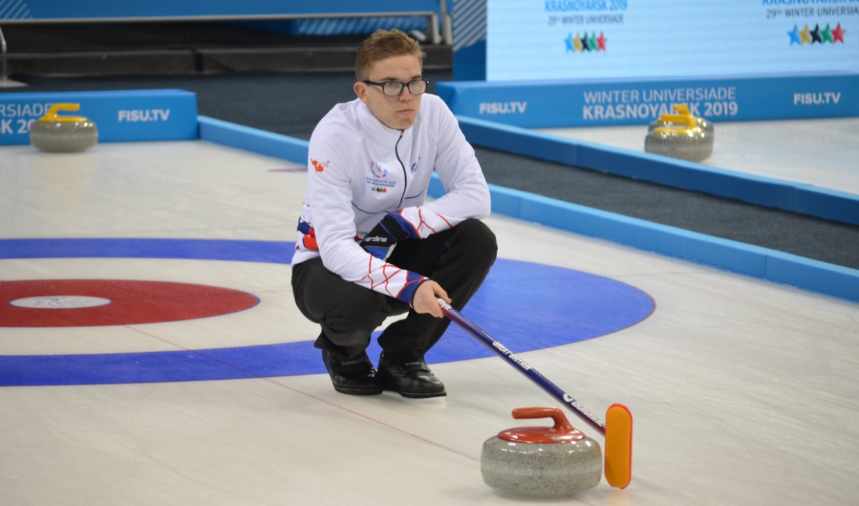 Ross Whyte at curling training at World University Winter Games
