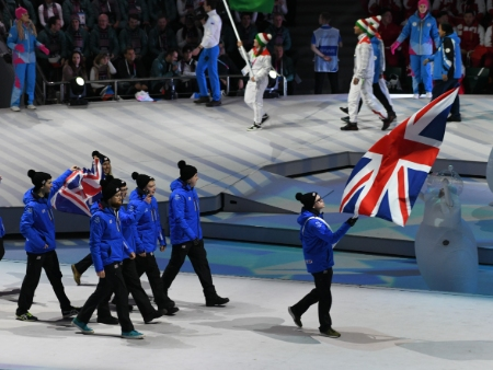 Curler flying GB flag at World Uni Winter Games