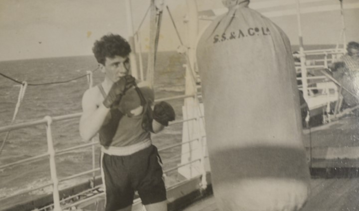 Scottish boxer Hugh Riley training on board the SS Tamora en route to the 1950 Games in Auckland, New Zealand