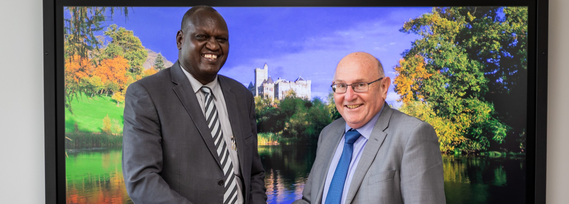 Professor Isaac Sanga Kosgey, Vice Chancellor of Moi University, and Professor Leigh Sparks, Deputy Principal of University of Stirling