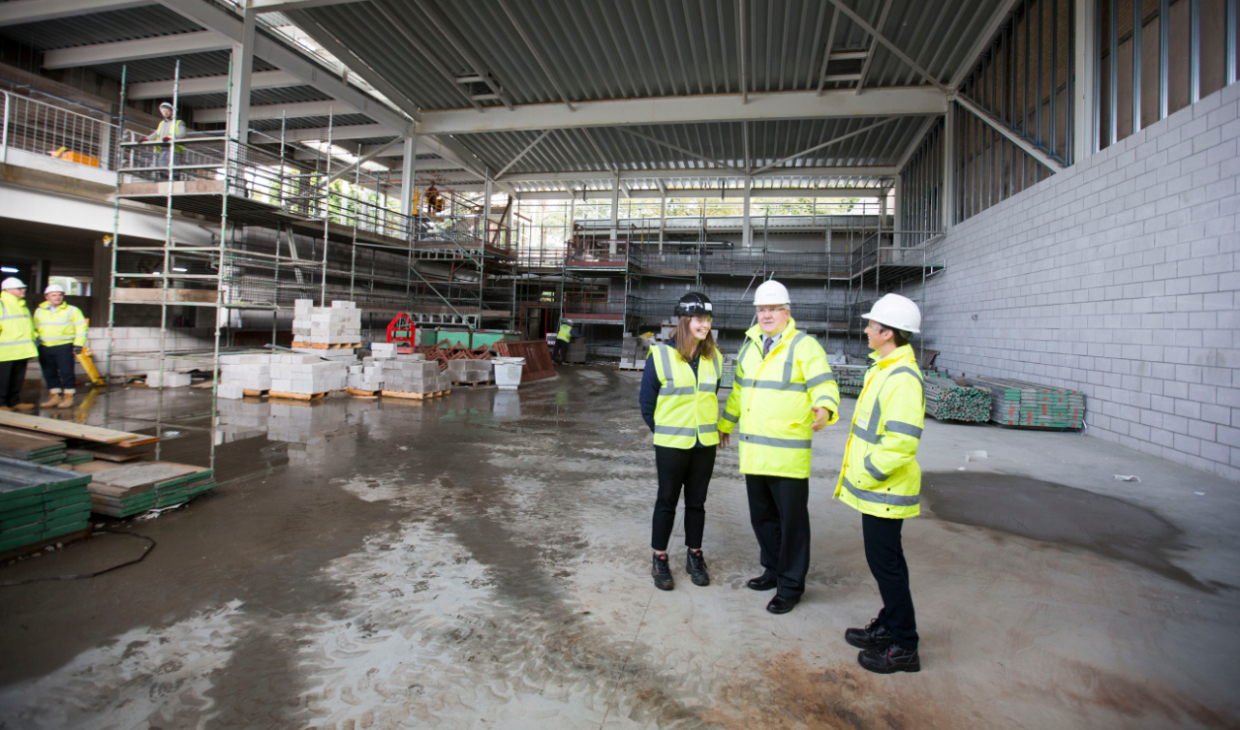 Sports Union President, Gill Thayne, Principal and Vice-Chancellor, Professor Gerry McCormac, and Executive Director of Sport, Cathy Gallagher, in the soon-to-be new three-court sports hall.