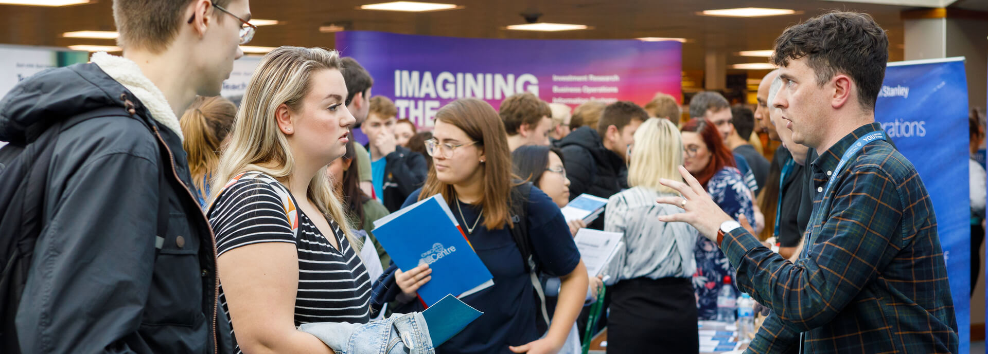 Students at a career fair stall