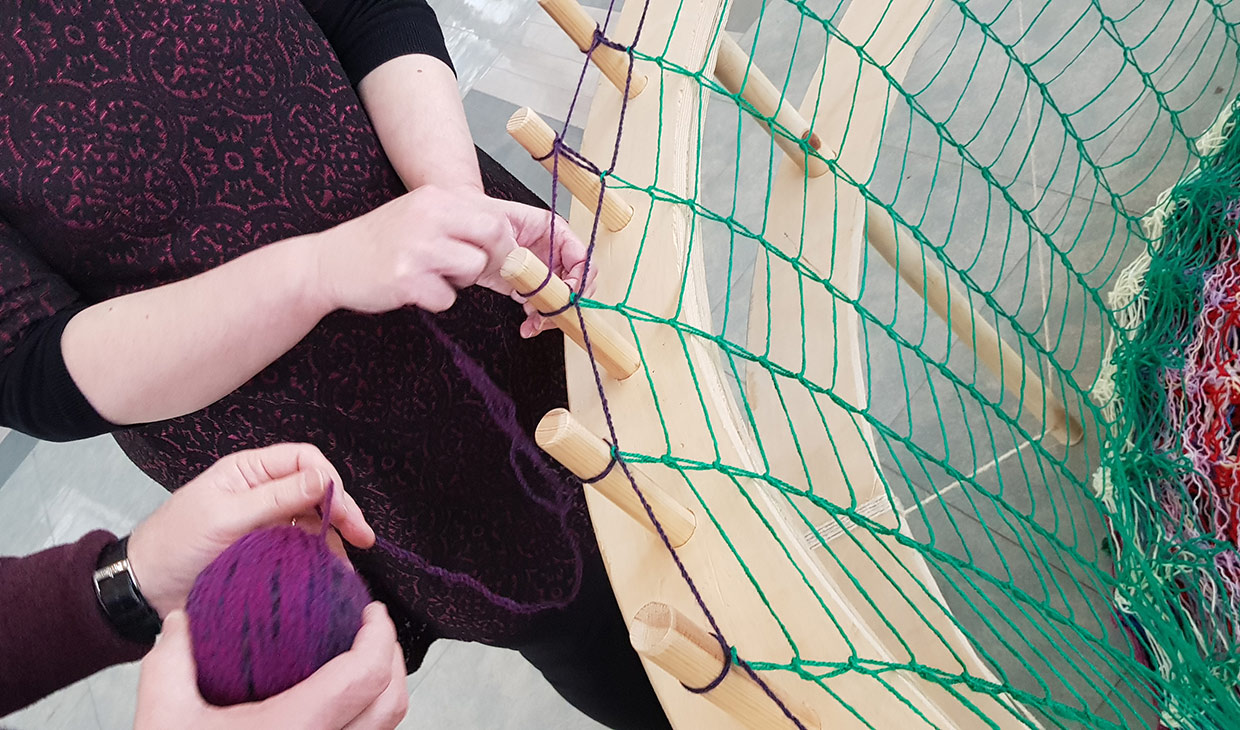 Community working on a basket