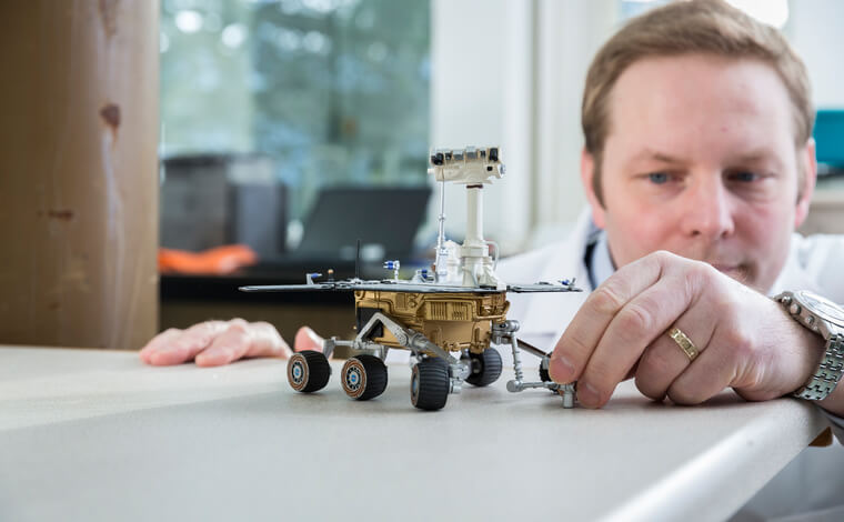 Christian Schroder with Mars rover model