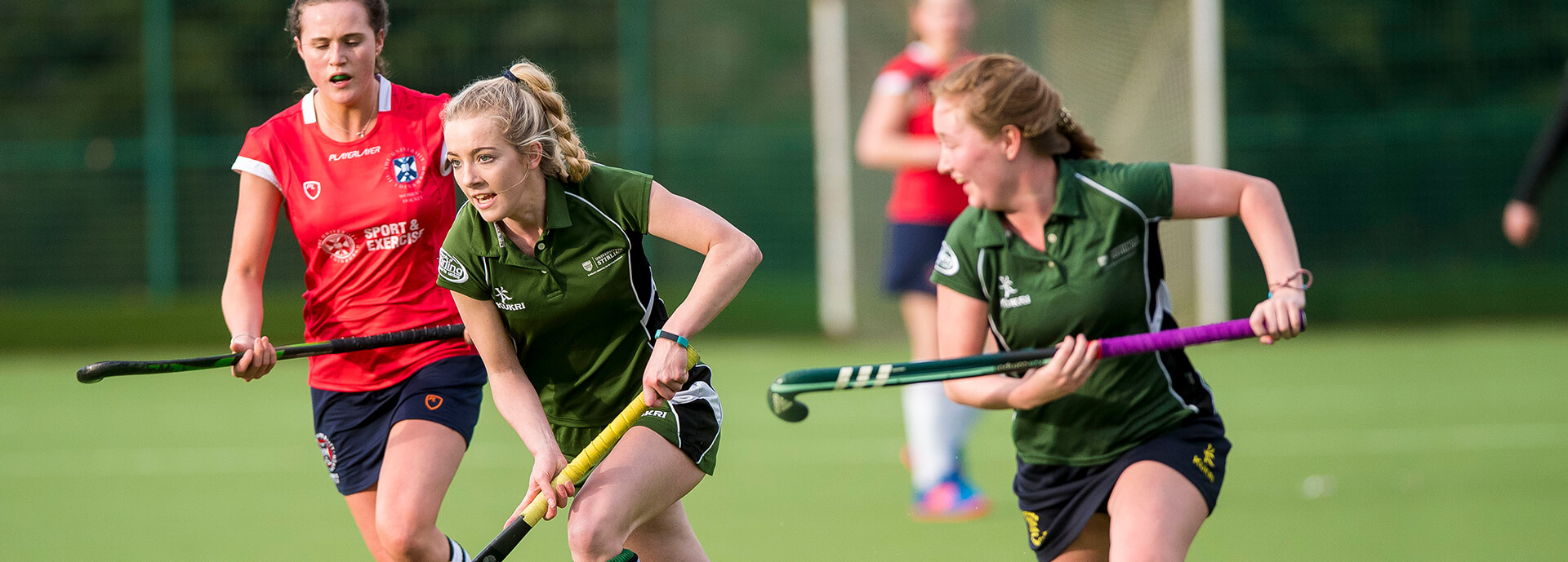 An image of female students playing hockey