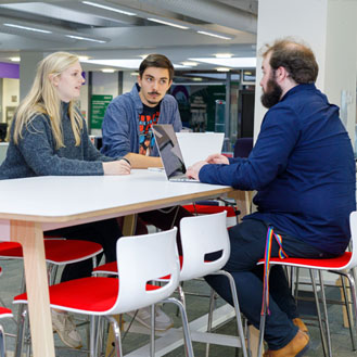 students at table in library