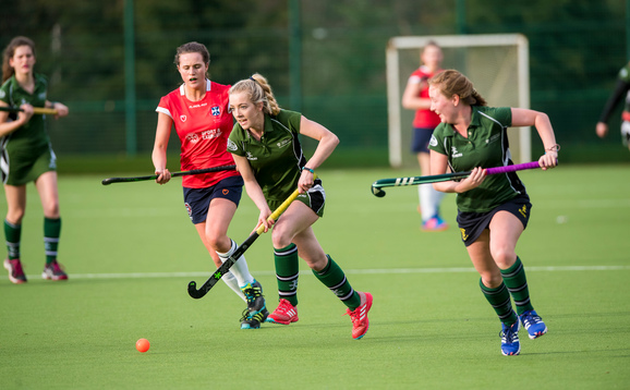 Women's team in action at hockey match