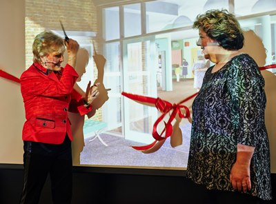 Angela Rippon cuts the ribbon at the Virtual Hospital opening watched by Professor June Andrews