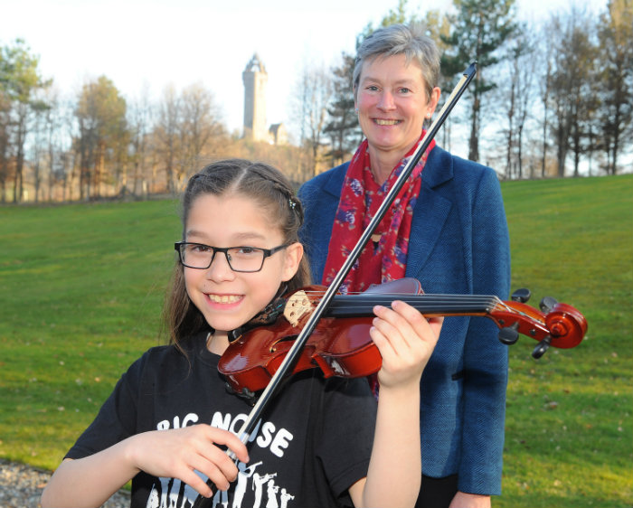 Centre Director Brigid Daniel with Big Noise viola player Milena at the launch of the University of Stirling Centre for Child Health and Wellbeing